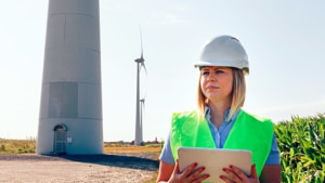Female wind power engineer with tablet